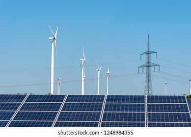 Electricity pylons, solar panels and wind turbines seen in Germany