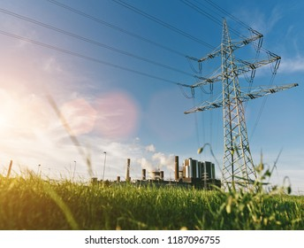 electricity pylons at sunset transporting clean renewable energy