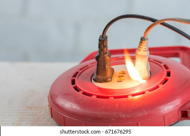 Electricity short circuit,Fire in overloaded power strip.