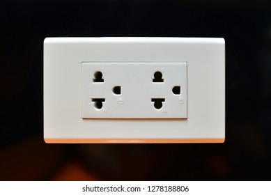 Electricity Socket on black wall background