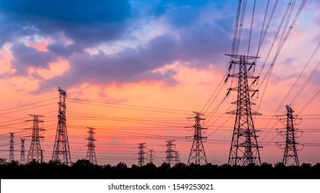 Electricity tower silhouette and sky landscape at dusk
