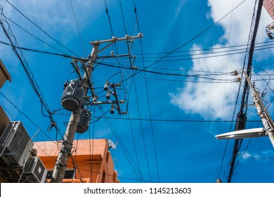 Electricity Transformer,  Electricity Pole, Cable Wires, Power Utilities and blue sky backgroud, Power Supply with Pole in City