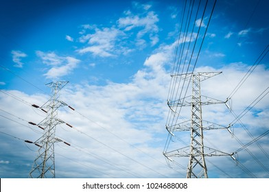 Electricity Transmission Line or Pylon, High voltage power to transfer the electricity from Power plant with the blue sky background.