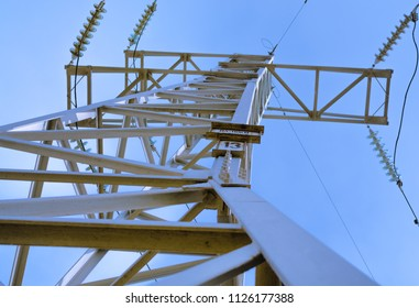 Electricity transmission power lines and blue sky.