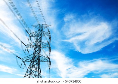 Electricity transmission power lines with blue sky (High voltage tower)