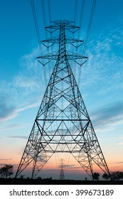 Electricity transmission power lines at sunset (High voltage tower)