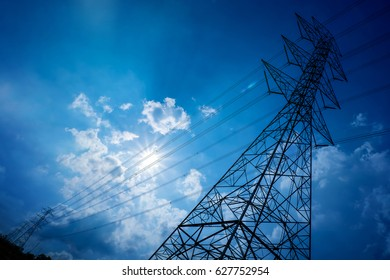 electricity transmission pylon silhouetted against blue sky. high voltage post.High-voltage tower sky background.