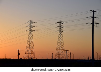 Electricity transmission towers with sunset background in Bakersfield, CA.
