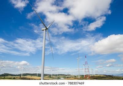 electricity wind turbine on hill