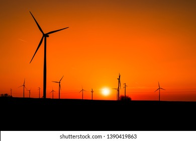 Electricity wind turbines at sunset