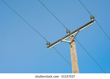Electricity wire and wooden pole on blue sky