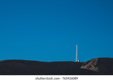 electricty tower stand alone on the mountain with blue sky