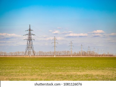 electrification of the country green grass field with tree lines