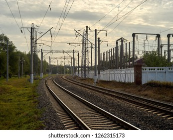 electrified railway, poles, rails, wires, summer in Russia