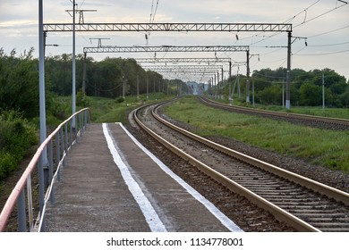 electrified railway in summer rails green grass wires
