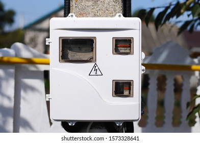 Electro shields. High voltage. Electric distribution. Box Evening.Electric shield on a concrete pole.