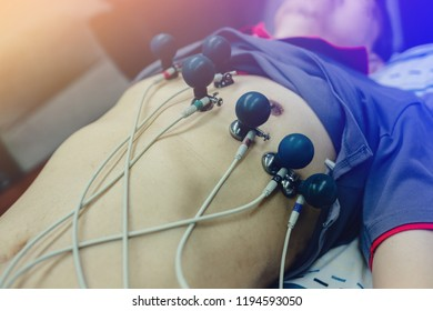 Electrocardiogram for heart and pulse measurement in hospital. Annual health check. Nurse measuring patients blood pressure electrocardiography. ECG