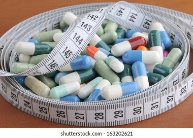 electrocardiogram with pills and tablets above, EKG medical health care and prevention