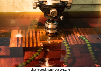 Electroerosive treatment of metallic form in a cooling dielectric liquid of red color. Manufacturing of a structure of high strength and complex shape.