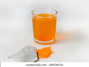 Electrolyte drink in a glass of white background