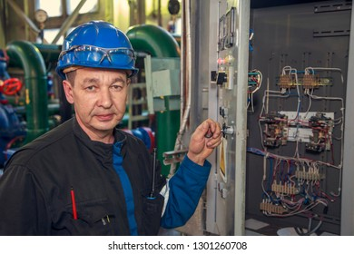 electromechanic near the electric cabinet