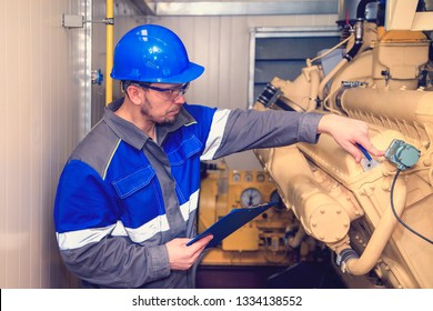 Electromechanic performs repair work on a diesel generator; toned