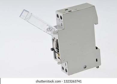 Electromechanical modular timer switch with opened transparent cover , light grey background