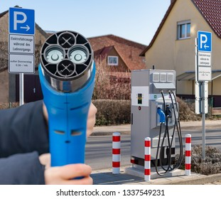 """electromobility - Charging station for an electric vehicle with 3 different connectors -  Translation: """"Electric vehicles during charging, except Thursday"""""""