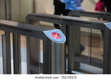 electronic access equipment on entrance gate with red cross