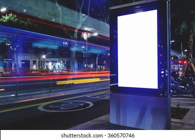 Electronic advertising board with copy space screen for your text message or content, banner with blurred movement of cars on background, empty poster outside, public information billboard on roadway