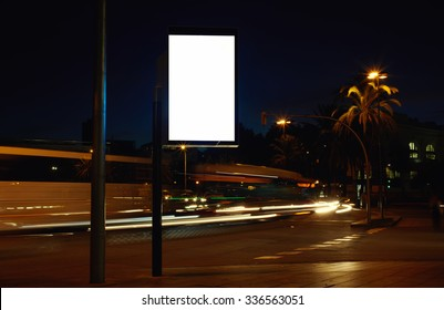 Electronic advertising board with empty screen copy space for your text message or promotion content, clear banner on the city at night, empty poster outdoors, public information billboard on roadway
