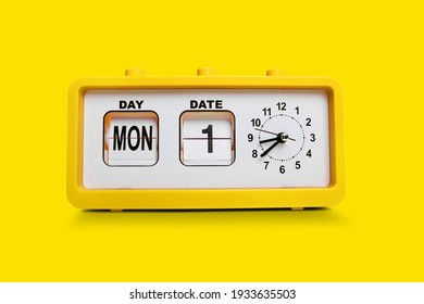 Electronic alarm clock and analog flip calendar. Retro design from 60s 70s home interior. Bright yellow color