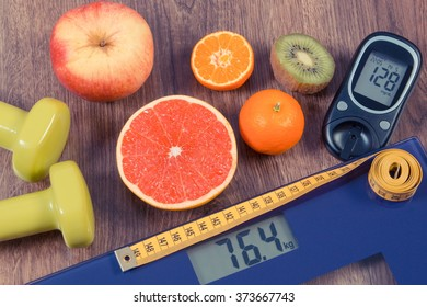 Electronic bathroom scale and glucose meter with result of measurement weight and sugar level, healthy food and dumbbells for fitness, concept of healthy lifestyles, diabetes and slimming