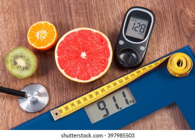 Electronic bathroom scale and glucose meter with result of measurement weight and sugar level, healthy food and stethoscope, concept of healthy lifestyles, diabetes and slimming