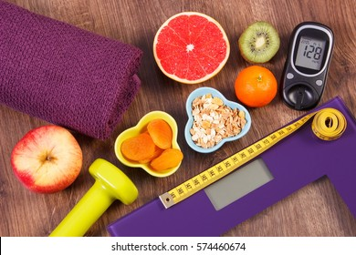 Electronic bathroom scale for weight of human body, tape measure and glucose meter, healthy food and dumbbells for using in fitness, concept of healthy lifestyles, diabetes and slimming