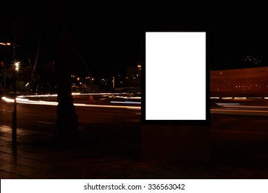 Electronic billboard with clear screen copy space background for your text message or promotional content, public information board in urban setting at night, advertising mock up banner on roadside