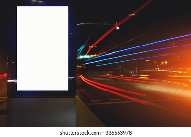 Electronic blank billboard with copy space for your text message or promotional content, public information board in night city with the movement cars on background, clear advertising mock outdoors
