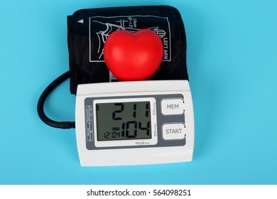 electronic blood pressure meter and red heart