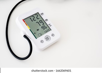 Electronic blood pressure monitor after test indicating the systolic, diastolic and pulse readings of a patient.