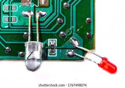 Electronic board with diodes. Elements of the TV remote control. Integrated circuits. Electronic circuit board isolated on white background.