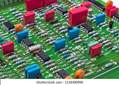 Electronic board with discrete elements, resistors, capacitors, transistors and microcircuits, close-up.