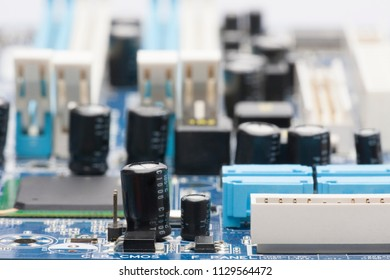 Electronic board. The board features elements: chips, diodes, capacitors, chokes. Shallow depth of field. Can be used as a background. There is a place for an inscription.
