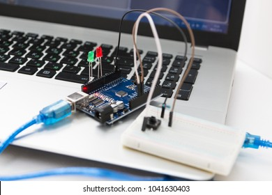 An electronic board that can be programmed. Robotics and electronics. Laboratory in the school. Mathematics, engineering, science, technology, computer code. STEM education for children.