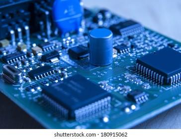 electronic board toned blue, close up photo