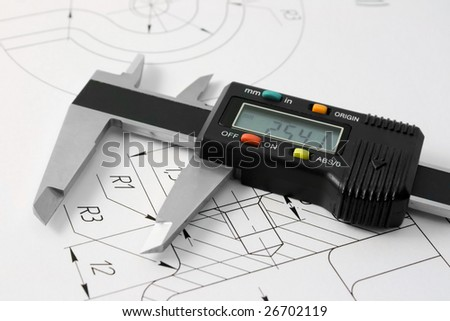 The electronic calliper lies on the detail drawing