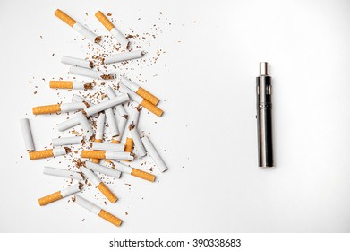 electronic cigarette against analog cigarettes is much better gloss chrome metal near the broken conventional cigarettes from which the tobacco poured