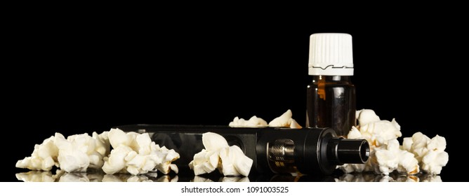 Electronic cigarette and bottle of fluid Smoking area, next to scattered popcorn isolated on black