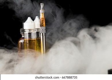 Electronic cigarette with bottles and big cloud of smoke