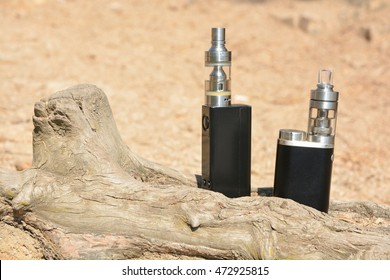 Electronic cigarette on a stone background