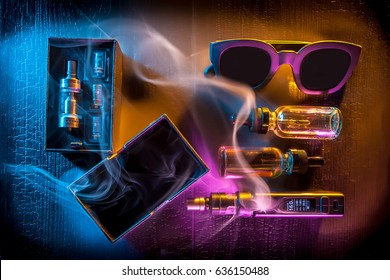 Electronic cigarette over a dark background. E-cigarette for vaping. Popular devices of the year - modern vaping device. Stop smoking.